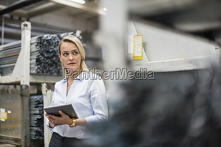 blond woman holding tablet in high