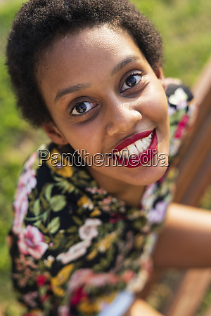 portrait of smiling young woman sitting