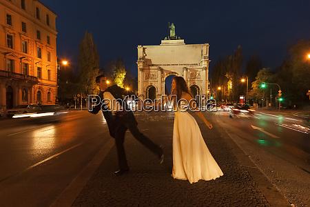 happy bridal couple crossing leopold street