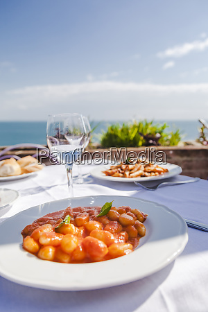 italy atrani plate of gnocchi with