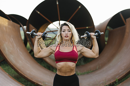 athletic woman doing weight workout at