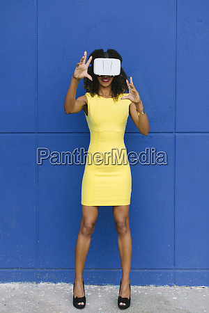 woman in yellow dress using virtual