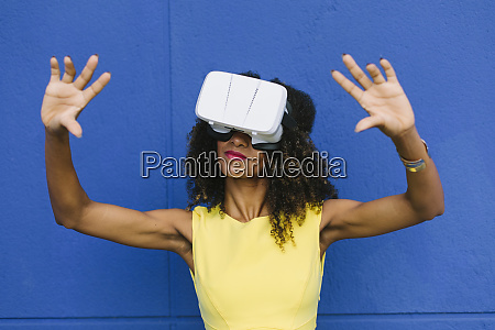 woman using virtual reality glasses against