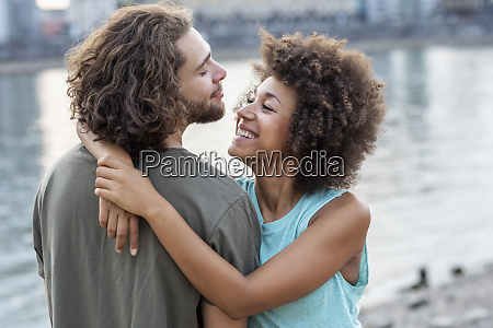 happy young couple hugging at the