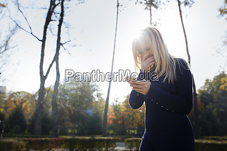 laughing blond woman looking at her