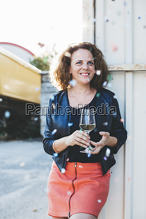 portrait of smiling woman with glass