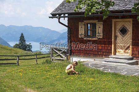 girl picking flowers in garden of