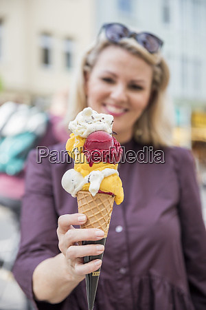 woman holding ice cream cone with