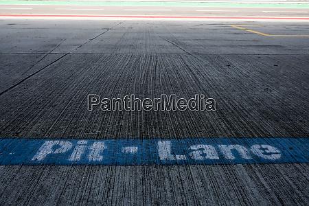 writing pit lane on racetrack