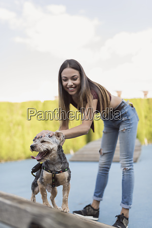 young woman training her dog in