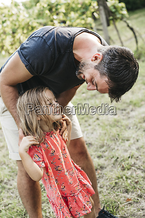 happy girl standing with father on