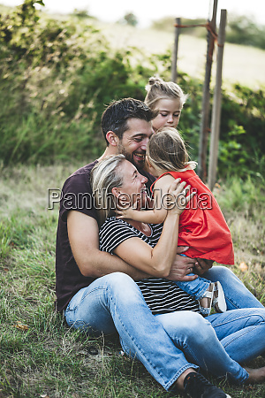 happy family with two daughters sitting