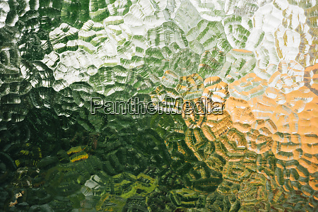 glass window with textures and green