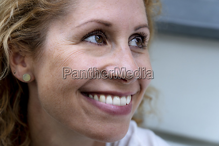 portrait of smiling woman with brown