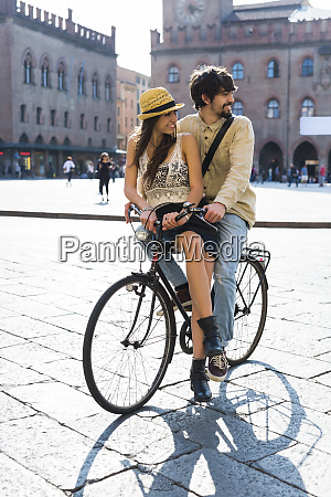 italy bologna young couple on bicycle