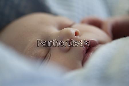 sleeping baby girl close up