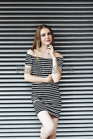 portrait of young woman wearing striped