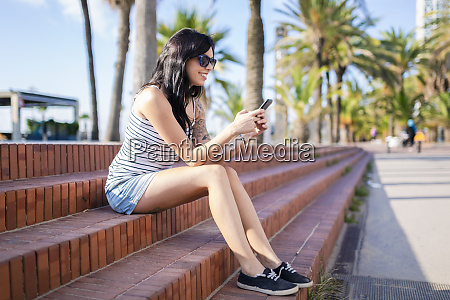 spain barcelona smiling young woman sitting