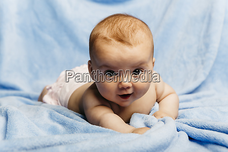 portrait of smiling baby girl lying