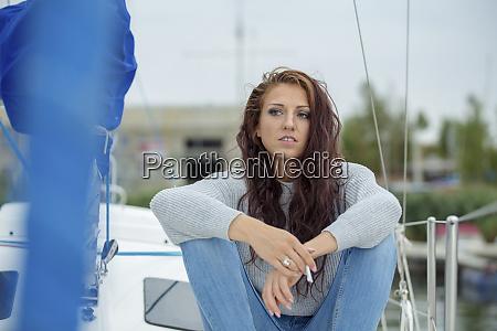 woman sitting on sailing boat waiting