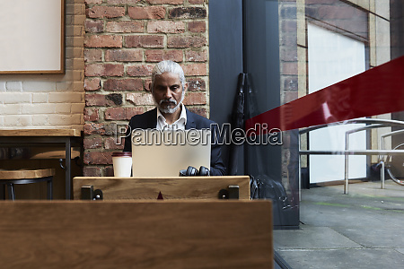 senior businessman working on laptop in