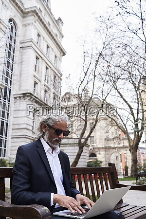 uk london senior businessman sitting on