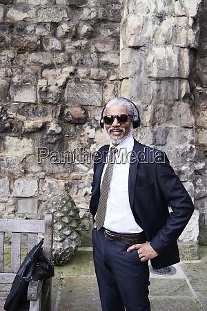 portrait of laughing senior businessman wearing