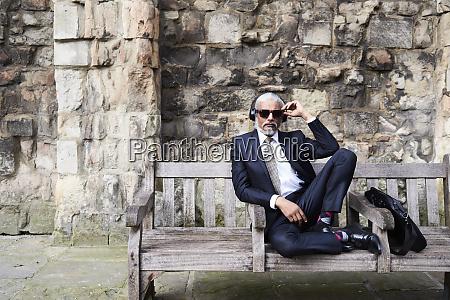 portrait of well dressed senior businessman