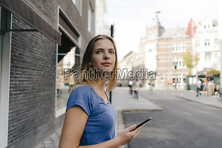 netherlands maastricht smiling young woman with