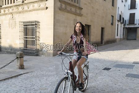 spain baeza smiling young woman riding