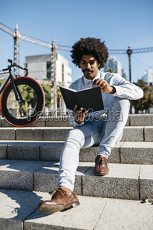 mid adult man with bicycle sitting