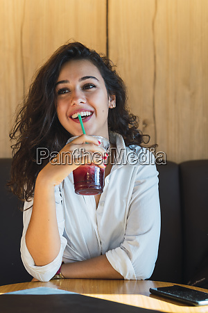 portrait of happy young woman drinking