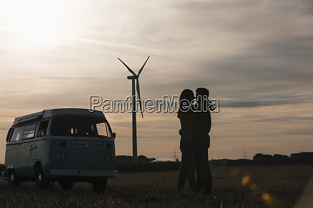 young couple kissing at camper van
