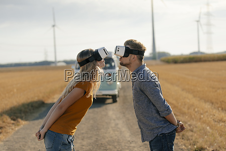 young couple wearing vr glasses kissing