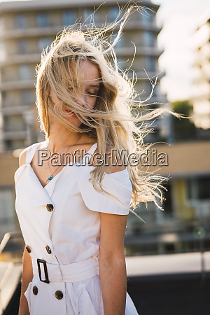 blond young woman with windswept hair