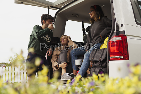 friends sitting in a camper taking