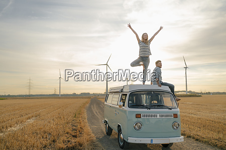young couple on roof of a