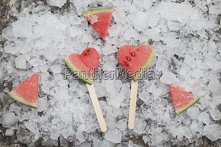 watermelon heart ice lollies on crashed