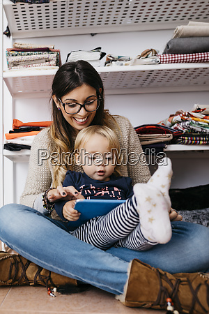 happy mother and little daughter sitting