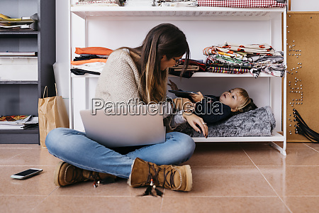 mother sitting on the floor at