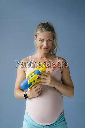 portrait of smiling pregnant woman holding