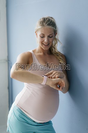 portrait of smiling pregnant woman standing