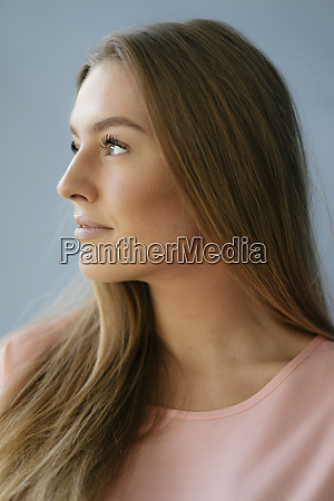 portrait of young woman looking up