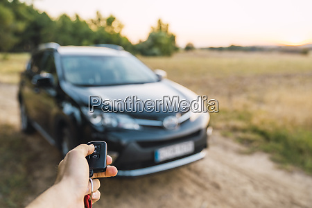 man opening car with remote control