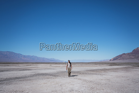 usa california death valley man walking