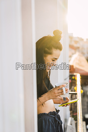 happy young woman on balcony above