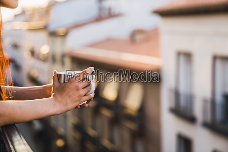 hands of woman on balcony above