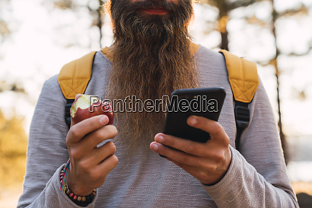 close up of bearded man using