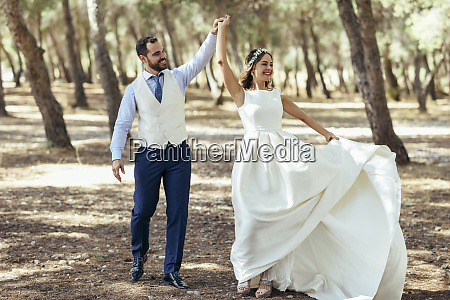 happy bridal couple dancing together in