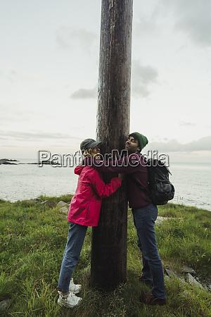 norway lofoten young couple hugging a